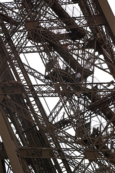 Closeup image of one leg of the Eiffel Tower in Paris