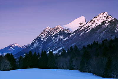Photograph at blue hour of the mountains of Massif des Bauges in winter