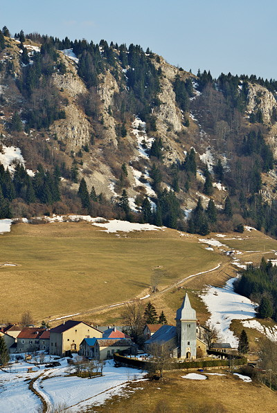 Photograph of Les Bouchoux village at the end of winter in Haut Jura Natural Park