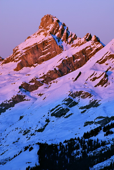 Photo of Pointe Percée by a winter dusk in Aravis mountain range