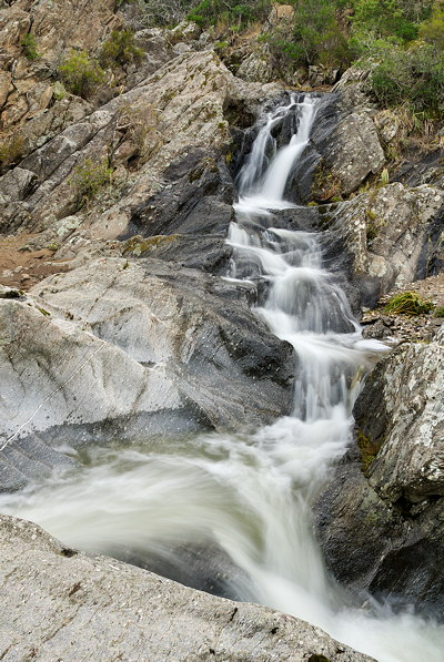 Image of a powerful stream running through Provence hills