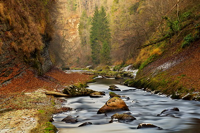 Long exposure photograph of autumn along the Cheran river in Massif des Bauges natural Park - France