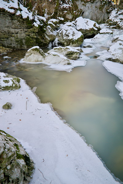 Photo of Fornant river in France covered with snow and ice