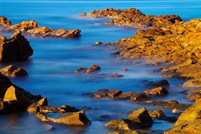Long exposure of some rocks bathing in the Mediterranean sea