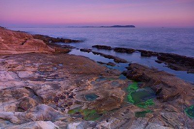 A mediterranean purple dusk at Bau-Rouge beach in Provence
