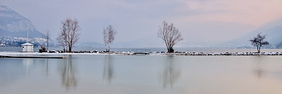 Panoramic image of Annecy lake in winter
