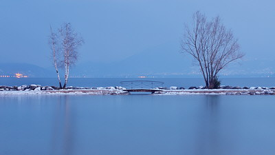 Photo of Annecy lake at blue hour in winter